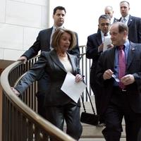 Rep. Michael Capuano, right, walks with House Speaker Nancy Pelosi on Capitol Hill in Washington, Tuesday, March 16, 2010. (AP)