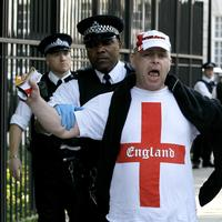 A supporter of the English Defence League is led away by police during a counter-protest to a pro-bin Laden rally outside the U.S. Embassy in London. (AP)