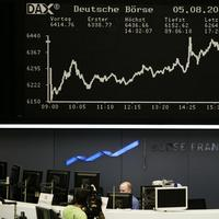 An electronic board shows the curve of the German index DAX at the stock exchange in Frankfurt, Germany. (AP)