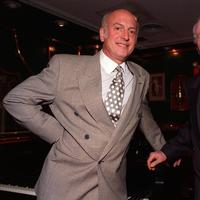 Songwriters Mike Stoller, left, and Jerry Leiber, right, pose in the Russian Tea Room in New York City, Thursday, July 23, 1992. (AP)