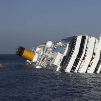 The cruise ship Costa Concordia lays on its side off the tiny Tuscan island of Giglio, Italy, on Jan. 18, 2012. (Andrea Sinibaldi, Lapresse via AP)