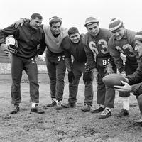 Left to right: Babe Parilli, Larry Eisenhauer, Bill Neighbors, Nick Buniconti, Ron Hall, and Gino Cappelletti during a practice session on Dec. 17, 1964 in Boston before a game with the Buffalo Bills.  (AP)