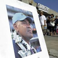 An image of football player Junior Seau in front of Qualcomm Stadium as fans arrived for a public memorial service in early May in San Diego. (AP)