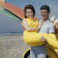 "In this 1963 photo, singer Frankie Avalon and actress Annette Funicello are seen on Malibu Beach during filming of ""Beach Party,"" in California in 1963. (AP)"