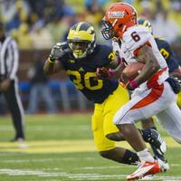 Illinois running back Josh Ferguson (6) tries to evade Michigan safety Thomas Gordon (30), in the third quarter of an NCAA college football game, Saturday, Oct. 13, 2012, in Ann Arbor, Mich. Michigan won 45-0. (Tony Ding/AP)