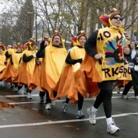Costumed participants run along Delaware Avenue in 2005's Turkey Trot in Buffalo, N.Y. (Don Heupel/AP)