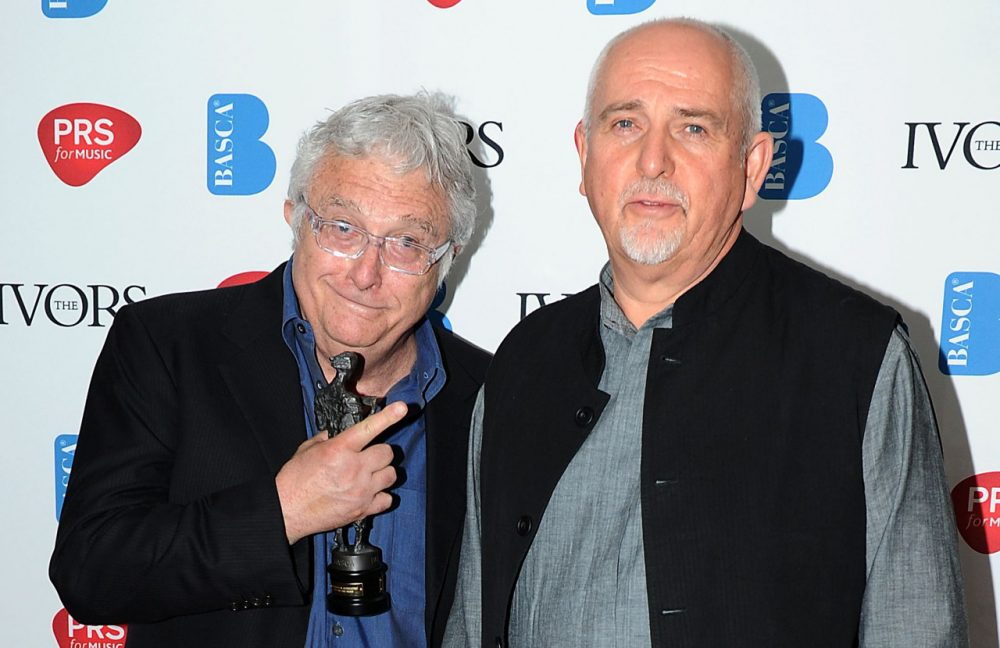 Randy Newman wins the Novello Award for 'PRS for Music Special International Award' presented by Peter Gabriel at the Grosvenor House in London on Thursday, May 16, 2013. (Mark Allan/Invision via AP)