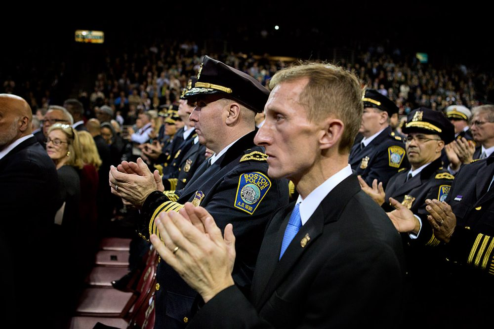 Police Commissioner William Evans, right, applauds during Mayor Marty Walsh's inaugural address. (Jesse Costa/WBUR)