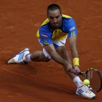 Viktor Troicki had his suspension reduced and will be back on the court in 18 months. (Petr David Josek/AP)