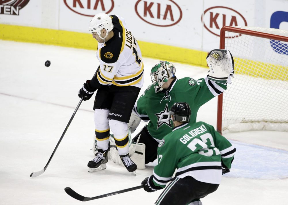Boston Bruins left wing Milan Lucic (17) pressures the net as Dallas Stars goalie Kari Lehtonen of Finland and Alex Goligoski (33) defends. (AP/Tony Gutierrez)