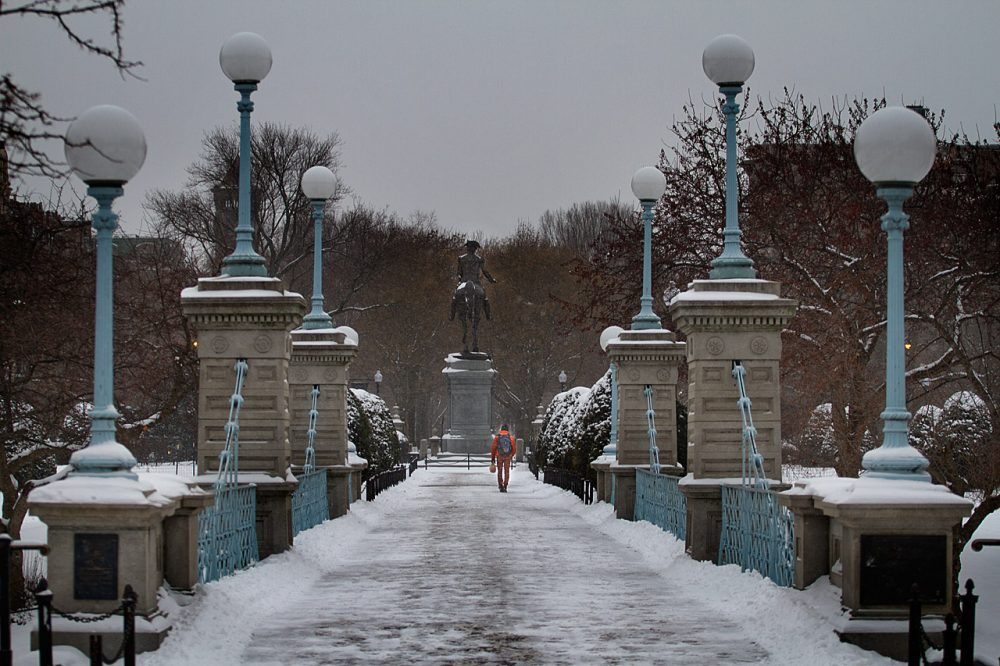 Man walking across the bridge in the Boston Public Gardens towards Commonwealth Ave.  (Jesse Costa/WBUR)