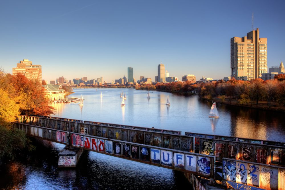 As the only spot in the U.S. where a boat can sail under a train driving under a car driving under an airplane, the B.U. bridge also offers a unique angle of the Boston skyline. (Nathan Lanier/Flickr)