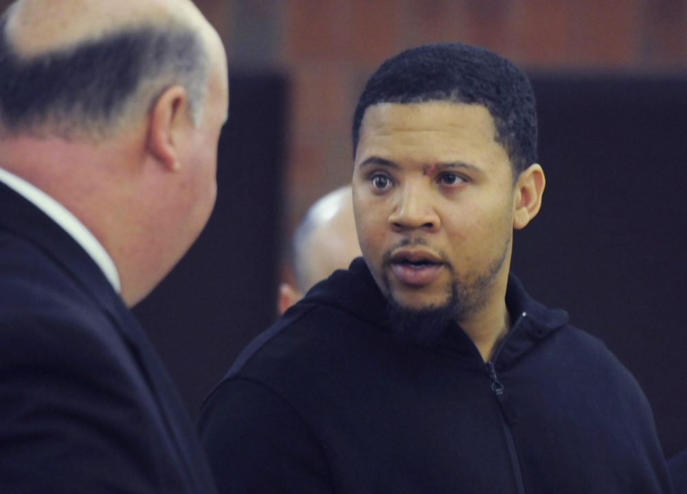 In this file photo, Alexander Bradley speaks with his attorney at Hatford Superior Court. Bradley, who alleges he was shot by Aaron Hernandez in February, was shot several times Sunday night. (Richard Messina/The Hatford Courant/AP)