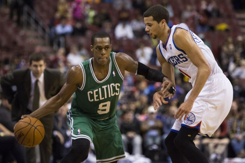Boston Celtics' Rajon Rondo, left, looks to make his move on Philadelphia 76ers' Michael Carter-Williams. (AP/Chris Szagola)