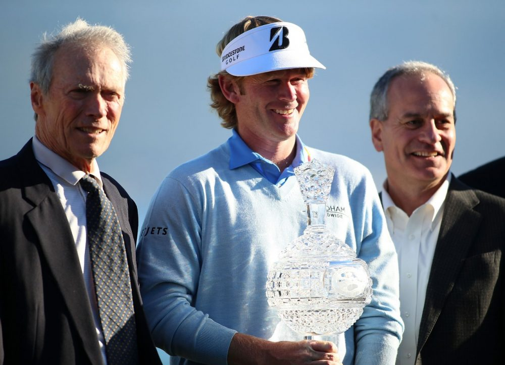 Clint Eastwood poses with Brandt Snedeker, winner of the 2013 AT&T Pebble Beach National Pro-Am. Eastwood's contribution to this year's tournament has already been more significant.  (Jed Jacobsohn/Getty Images)
