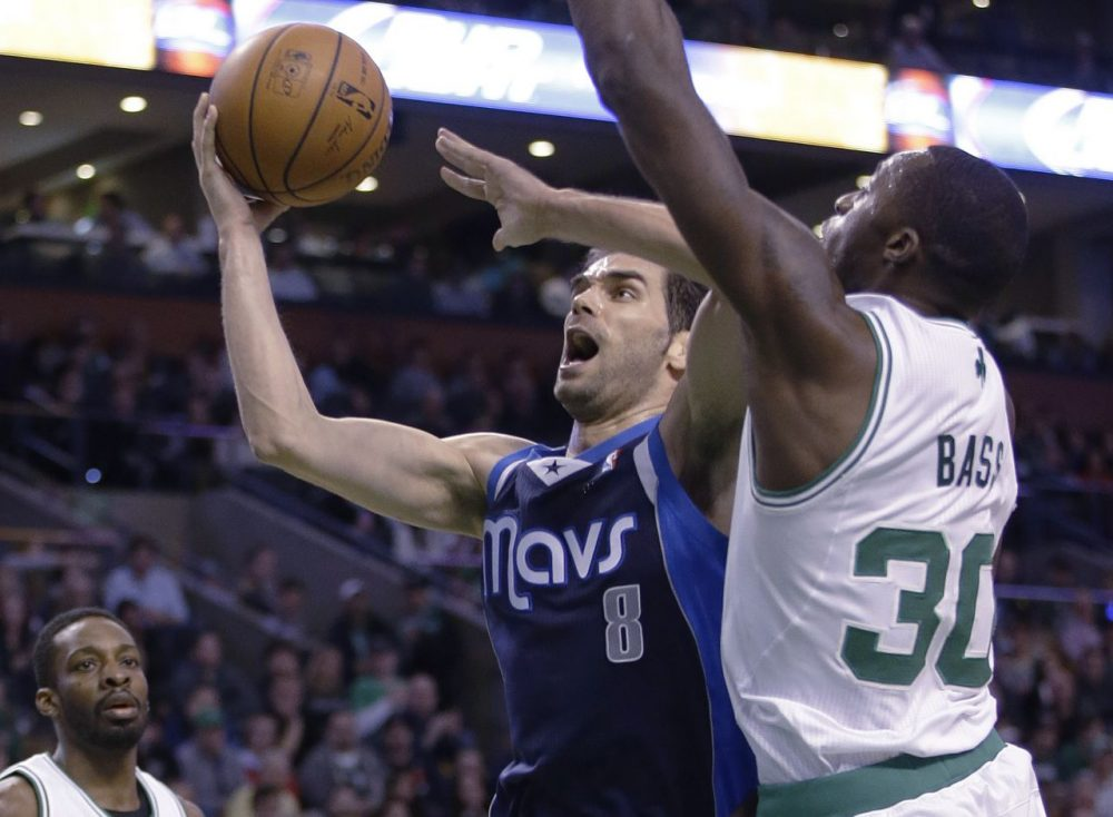 Dallas Mavericks point guard Jose Calderon (8) takes the ball to the hoop past Boston Celtics power forward Brandon Bass (30) during the second half of their NBA basketball game as Boston Celtics small forward Jeff Green (8) looks on in Boston, Sunday, Feb. 9, 2014. The Mavericks defeated the Celtics 102-91. (Stephan Savoia/AP)