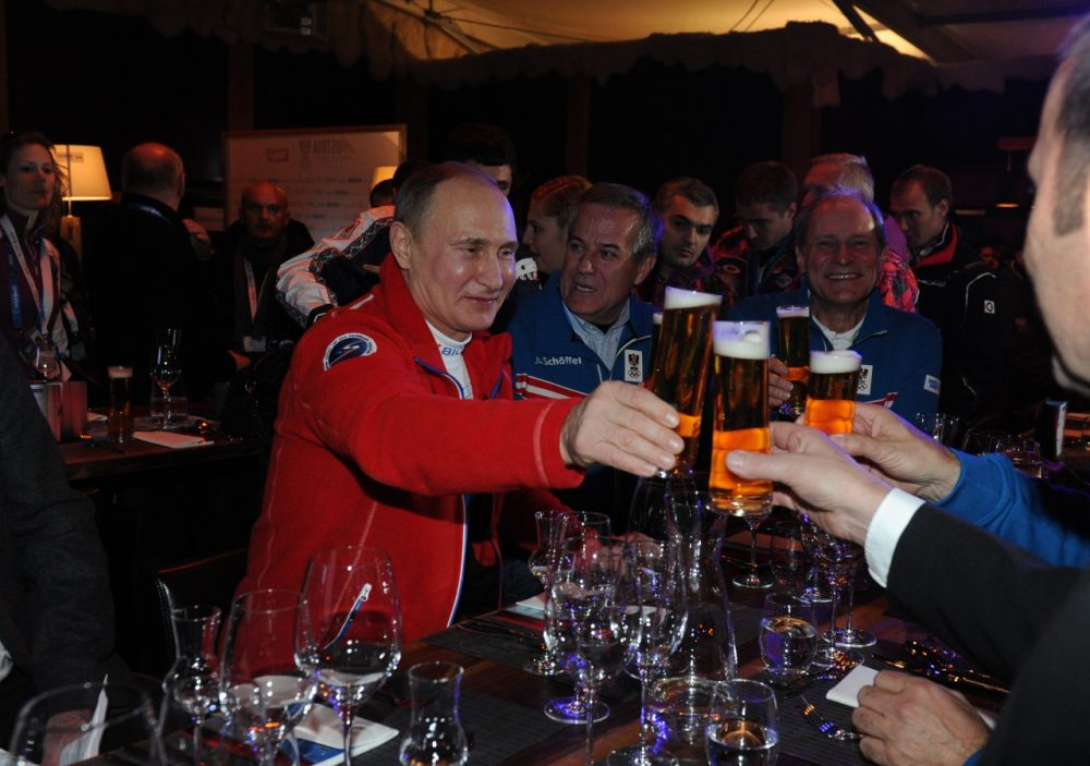 Russian President Vladimir Putin hasn't had trouble finding a beer in Sochi. Spectators haven't been so lucky. (Mikhail Klimentyev/AFP/Getty Images)