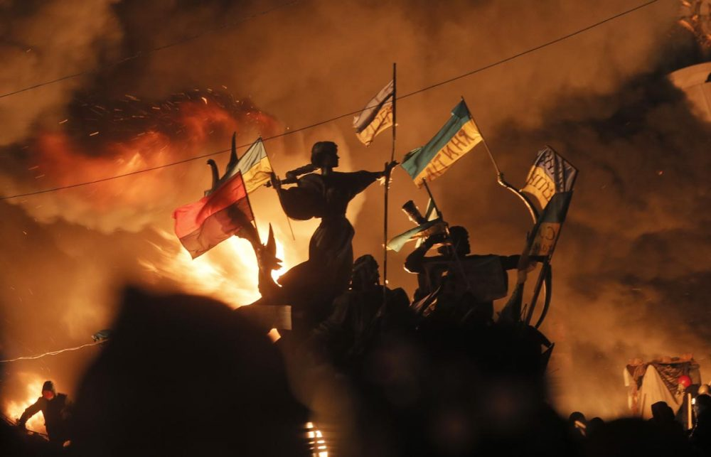 Monuments to Kiev's founders burn as anti-government protesters clash with riot police in Kiev's Independence Square, the epicenter of the country's current unrest, on Tuesday. (Efrem Lukatsky/AP)