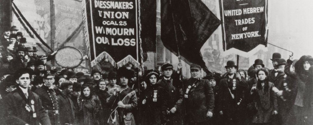 "Workers gather after the 1911 Triangle Shirtwaist Factory fire in New York, which became a rallying cry for miserable working conditions. It's part of the backdrop for Alice Hoffman's ""The Museum of Extraordinary things."" (AP/National Archives)"