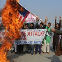 Pakistani protesters burn a representation of the U.S. flag to condemn American drone strikes on militants' hideouts in Pakistani tribal areas, Thursday, Dec. 26, 2013 in Multan, Pakistan. The U.S. is now said to be considering legal options for using an unmanned drone to kill an American citizen in Pakistan. (AP)