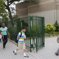 Students enter MS88, a New York City public middle school in the Brooklyn borough of New York on Wednesday, Aug. 7, 2013. A new AMA study suggests stress habits formed as young adults will follow teens throughout their lives. (AP)