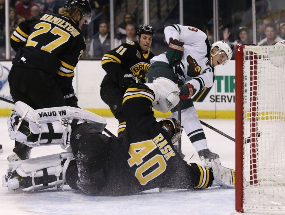 Boston Bruins goalie Tuukka Rask (40) drops to the ice to make a save on a shot by Minnesota Wild center Mikko Koivu (9). (AP/Charles Krupa)