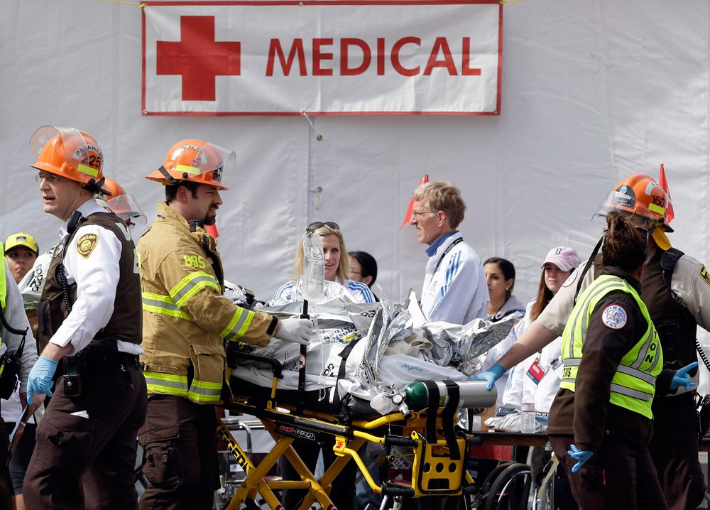 Medical personnel work outside the medical tent after the Boston Marathon bombing on April 15 & Carrying Memories Marathon Medical Team Prepares For Possible ...
