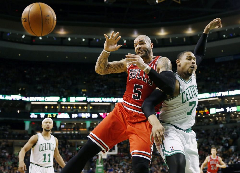 The ball goes out of bounds as Chicago Bulls' Carlos Boozer (5) and Boston Celtics' Jared Sullinger (7) battle for a rebound. (AP/Michael Dwyer)