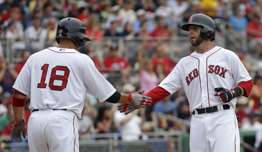 Shane Victorino (left) and Dustin Pedroia (right) are back after helping the Red Sox win the World Series in 2013. (Gerald Herbert/AP)