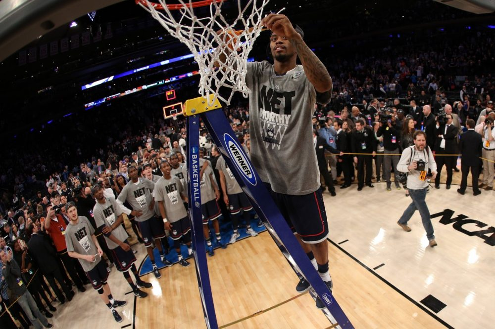 When UConn beat Michigan to advance to the Final Four, it was worthy of a net cutting ceremony. But with seven postseason tournaments are too many nets facing the scissors? (Bruce Bennett/Getty Images)