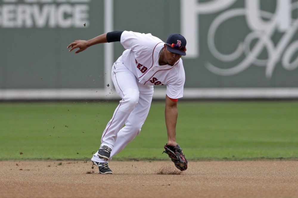 Boston Red Sox shortstop Xander Bogaerts fields a groundout during an exhibition baseball game in Fort Myers, Fla., Saturday, March 29. (AP/Gerald Herbert)