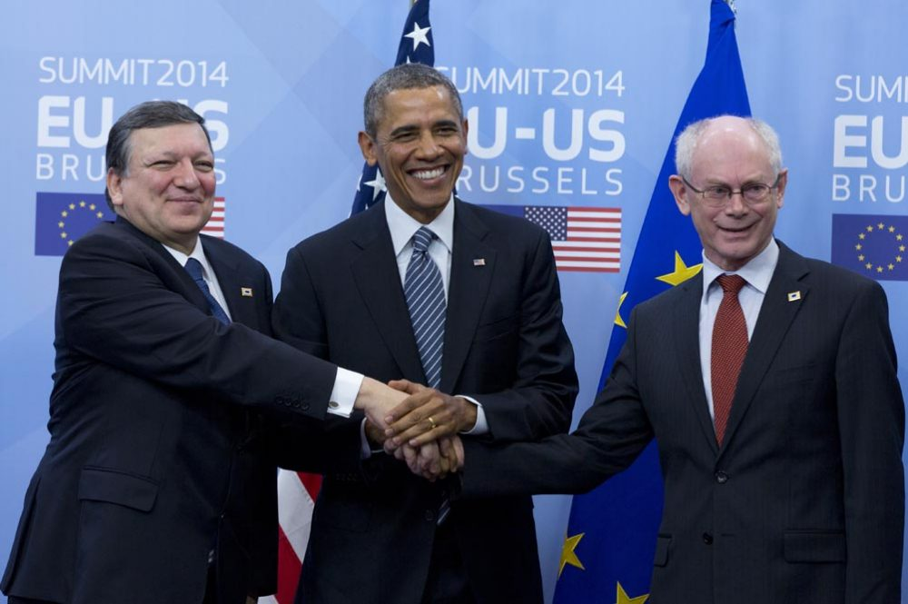 U.S. President Barack Obama, center, shakes hands with EU Council President Herman Van Rompuy, right, and EU Commission President Jose Manuel Barroso, left, prior to an EU-US summit meeting at the EU Council building in Brussels on Wednesday, March 26, 2014. Obama is on a one day trip to Belgium to meet EU officials and visit the WWI Flanders Field Cemetery. (AP)
