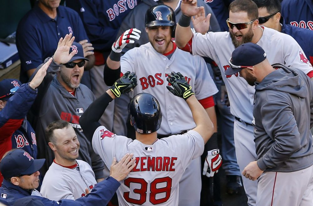 Teammates greet Boston Red Sox' Grady Sizemore (38) in the dugout after he hit a solo home run in the fourth inning.  (AP/Patrick Semansky)