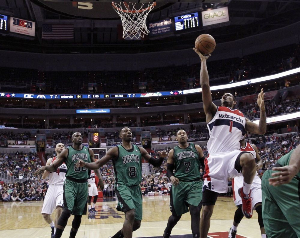 Washington Wizards forward Trevor Ariza (1) shoots in front of Boston Celtics center Joel Anthony (50), forward Jeff Green (8) and center Jared Sullinger (7) during the second half of an NBA basketball game Wednesday, in Washington. (AP Photo/Alex Brandon)