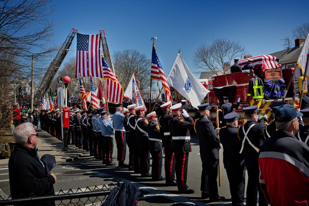 Engine 33 passes through down Centre Street on its way to Forest Hills Cemetery. (Jesse Costa/WBUR)