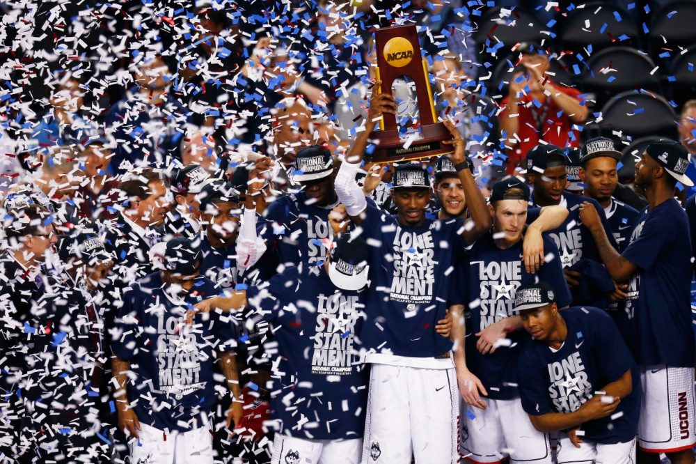 The UConn men's basketball team celebrates their national championship victory. (Tom Pennington/Getty Images)