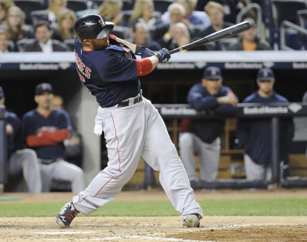 Boston Red Sox batter Jonny Gomes hits a home run during the sixth inning of a baseball game against the New York Yankees. (Bill Kostroun/AP)