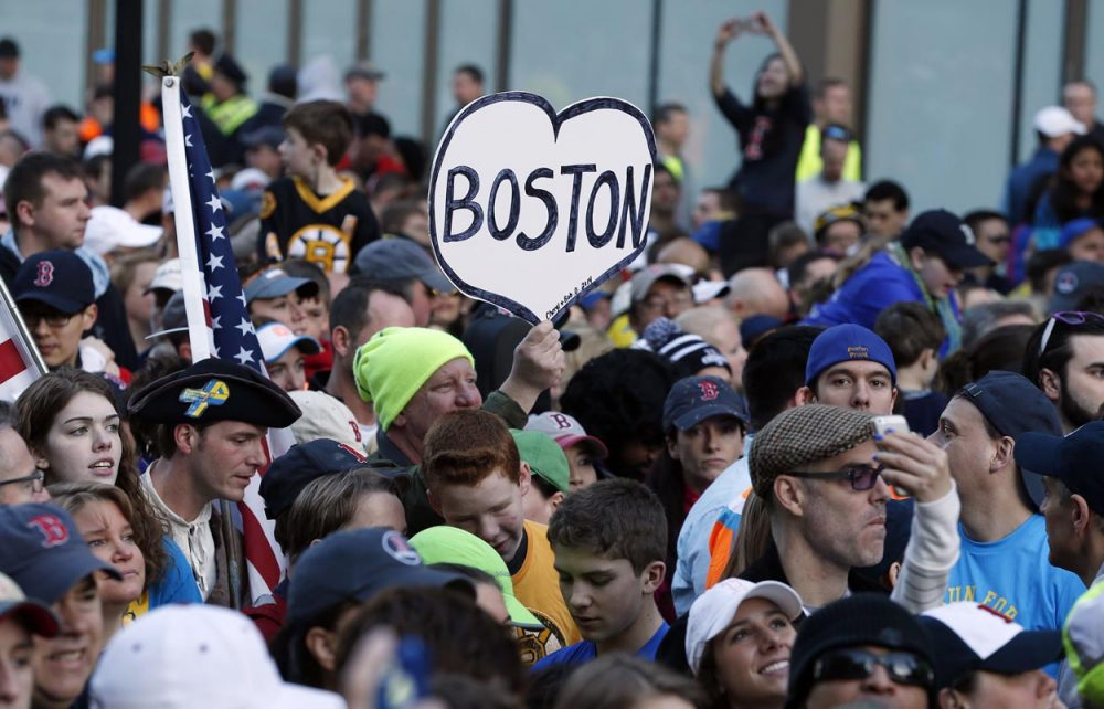 A crowd gathered at the finish line of the Boston Marathon Saturday morning for a Sports Illustrated cover shoot before the one-year anniversary of the bombings. (Michael Dwyer/AP)