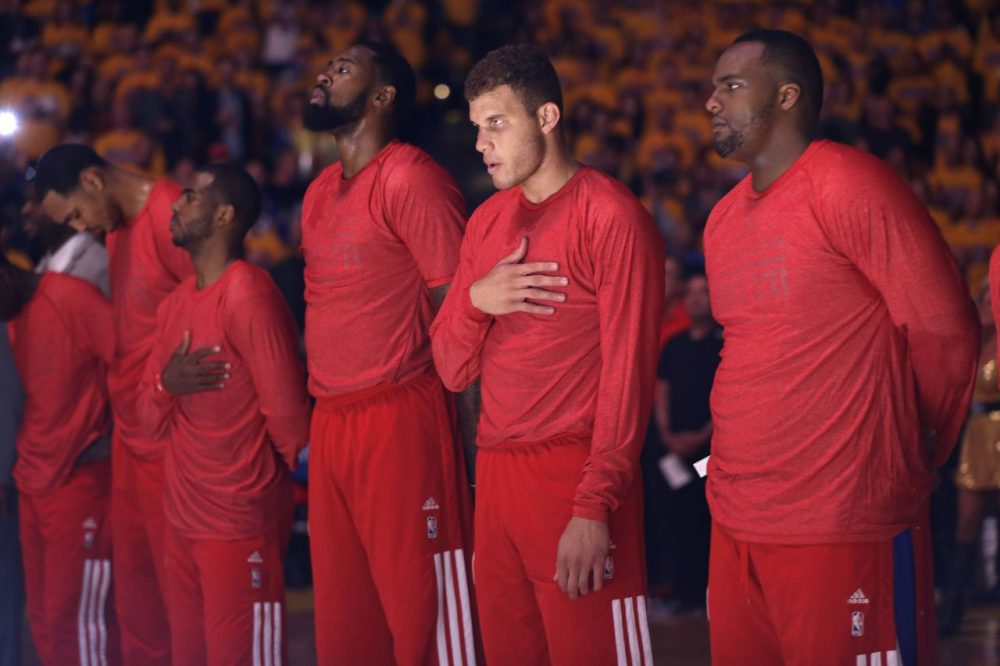 Los Angeles Clippers players listen to the national anthem wearing their warmup jerseys inside out to protest alleged racial remarks by team owner Donald Sterling. (Marcio Jose Sanchez/AP)