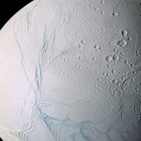 "This undated photo provided by NASA on April 2, 2014 shows Saturn's moon Enceladus. The ""tiger stripes"" are long fractures from which water vapor jets are emitted. Scientists have uncovered a vast ocean beneath the icy surface of the moon, they announced Thursday, April 3, 2014. Italian and American researchers made the discovery using Cassini, a NASA-European spacecraft still exploring Saturn and its rings 17 years after its launch from Cape Canaveral. (AP)"