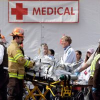 Medical personnel work outside the medical tent after the Boston Marathon bombing on April 15, 2013. (Elise Amendola/AP)