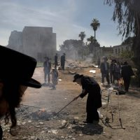 Ultra-Orthodox Jewish men burn leavened items in final preparation for the Passover holiday in the ultra-Orthodox Jewish town of Bnei Brak, near Tel Aviv, Israel, Monday, April 14, 2014. Jews are forbidden to eat leavened foodstuffs during the Passover holiday that celebrates the biblical story of the Israelites' escape from slavery and exodus from Egypt. (AP)