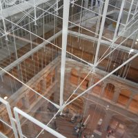 Looking down from the glass-roofed atrium of the renovated Harvard Art Museums to the courtyard floor five stories below. (Greg Cook)