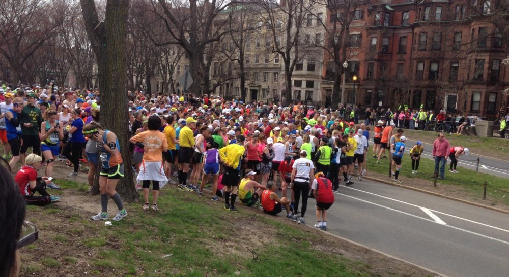 Boston Police stop marathon runners with less than a mile to go, minutes after word of a explosions near the finish line. (Courtesy Kevin Donovan)