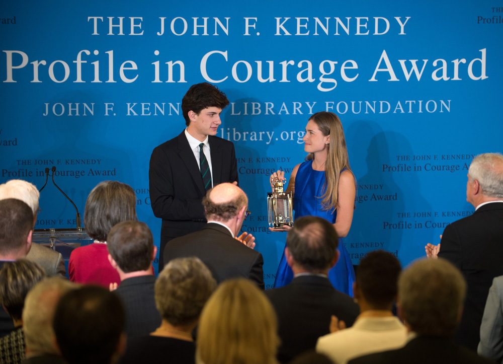 Lauren Bush Lauren, right, granddaughter of former President George H.W. Bush, accepts the 2014 John F. Kennedy Profile in Courage Award on behalf of her grandfather from Jack Schlossberg, left, grandson of President John F. Kennedy, during a ceremony at the John F. Kennedy Library and Museum, Sunday in Boston. (Gretchen Ertl/AP)