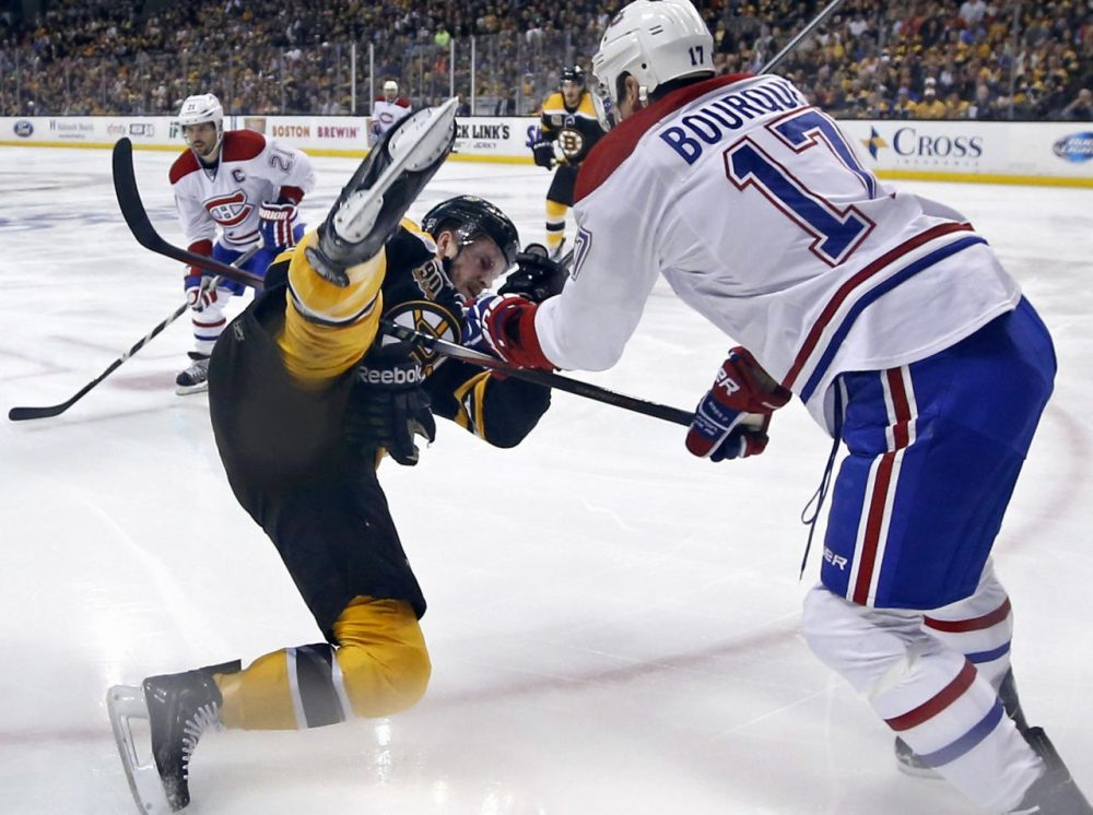 Montreal Canadiens left wing Rene Bourque (17) dumped Boston Bruins defenseman Kevan Miller to the ice during the first period in Game 2, but the Bruins evened the series with a 5-3 win. (Elise Amendola/AP)