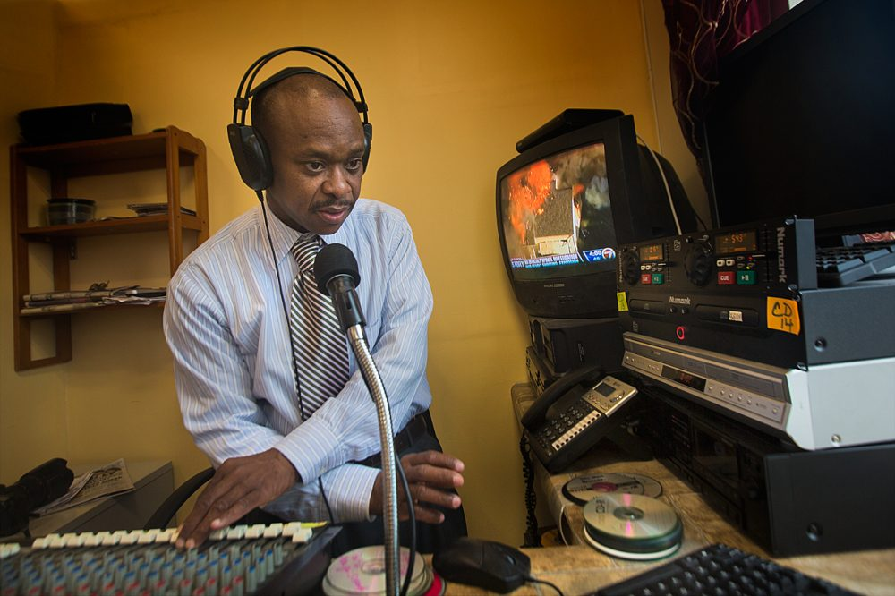 David Cange broadcasts on the unlicensed Radio Bel Top in Mattapan. (Jesse Costa/WBUR)