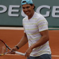 Rafael Nadal has won the French Open eight times, but he still needs one more win to pass Max Decugis. (Bertrand Combaldieu/AP)