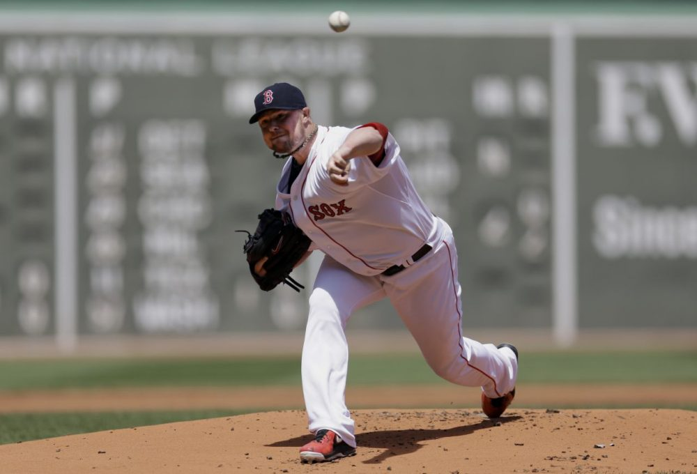 Jon Lester struck out 12 in seven shutout innings. (Steven Senne/AP)