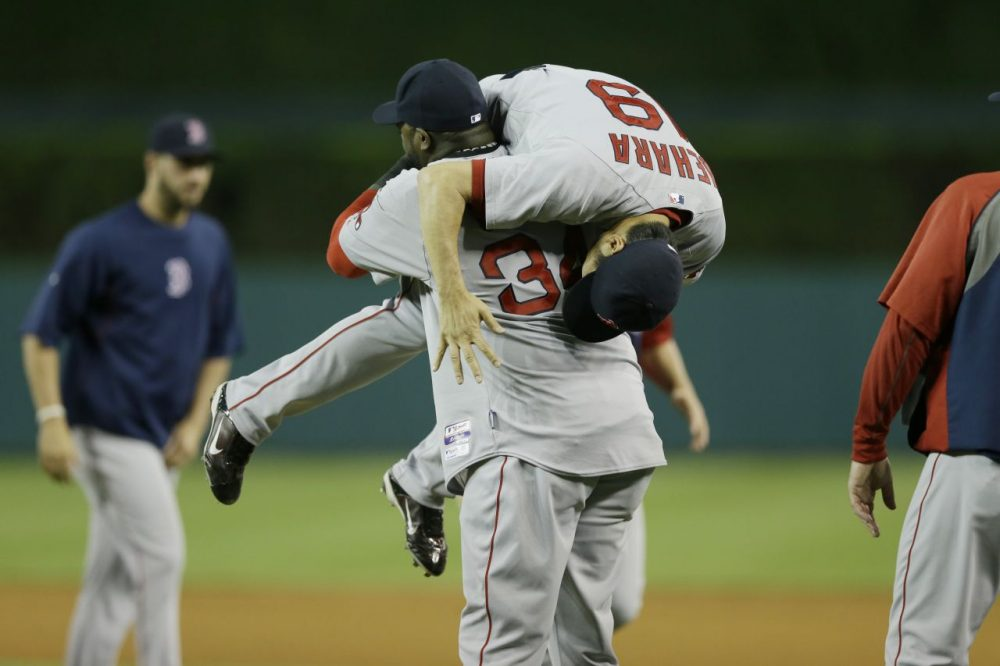 David Ortiz picks up relief pitcher Koji Uehara after Boston's 5-3 win over the Detroit Tigers. (Carlos Osorio/AP)